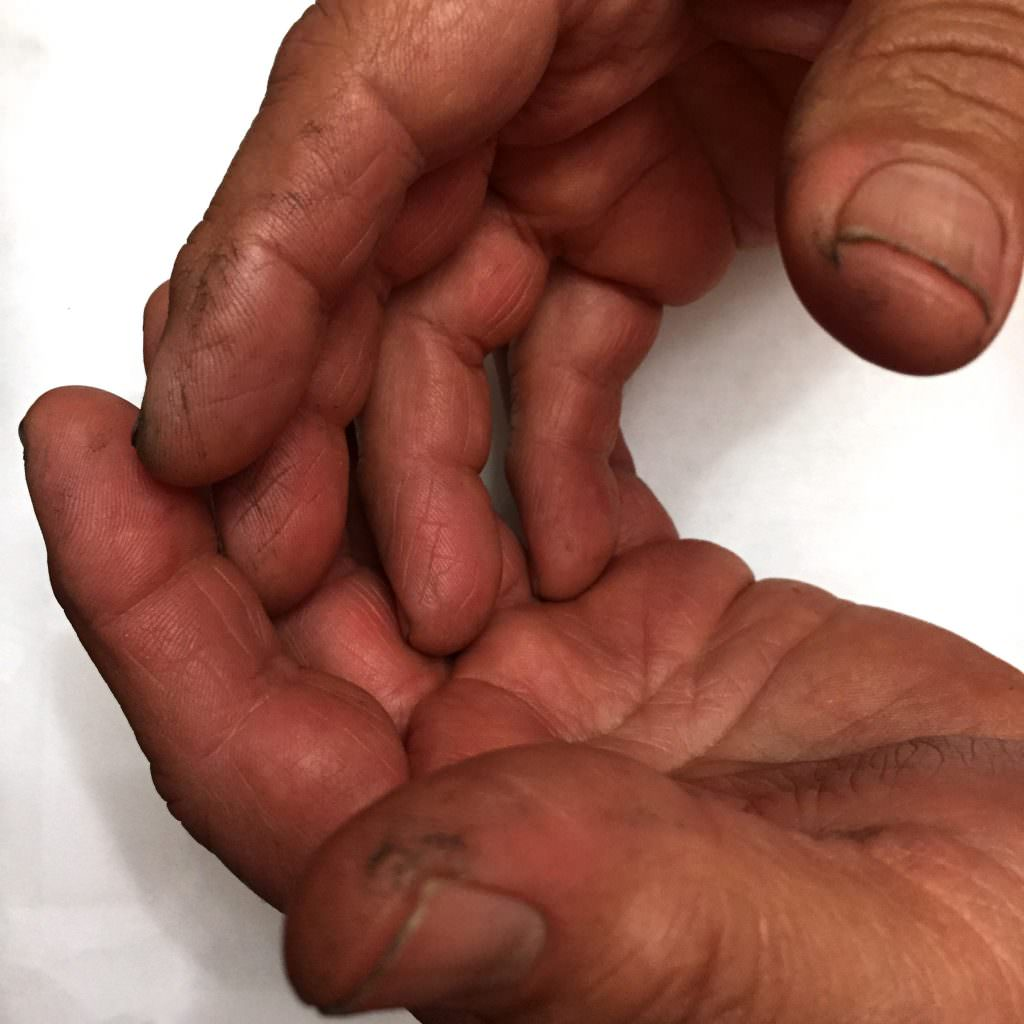 Close up photo of hard-working hands